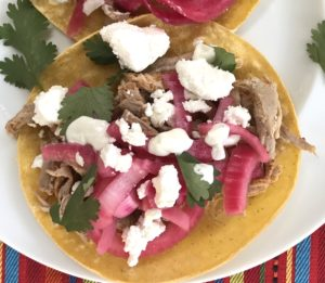 These Pork Carnitas Tacos  have shredded pork tenderloin topped with pickled red onions, goat cheese & tangy cilantro lime crema.  On the side, Creamy Corn with goat cheese...wha!?!?  Yep, goat cheese is tangy, sweet, salty and oh-so-creamy for an unexpected, but absolutely delicious combination!