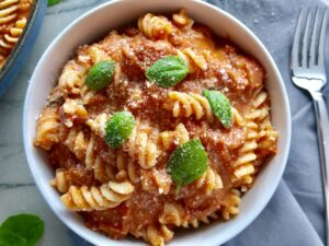 This Luscious Tomato Cream Sauce Pasta tastes amazing - and it's amazingly simple to make!! I call it Luscious because the tomatoes, which are still slightly chunky become this thick, creamy, smooth, velvety, and flavorful sauce. The combination of the San Marzano tomatoes and sour cream takes a simple red sauce to a perfect pink heavenly cream sauce!