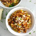 Anniversary Slow Cooker Beef Bolognese is a souped-up version of the traditional Italian Meat Sauce made EASY in the slow cooker! The flavors of the ingredients with the meat become one and turn into this amazing thick sauce. I add even MORE FLAVOR with Pancetta and Demi-Glace. Delicious!