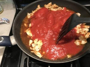 This Skillet Ground Chicken Tomato Sauce with Ricotta is a delicious and simple one pan meal. Ground chicken is seared until it gets a super browned, flavorful crust. Then garlic, vegetable broth and tomatoes are added and cooked down into a delightful sauce that really lets the tomato shine with a meaty bite from the chicken. After pasta is mixed in, creamy Ricotta Cheese is dolloped on and fresh basil added to garnish. It's perfection!Bellissimo!