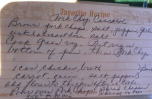 My Mom's original recipe card for Pork Chop Casserole. Smothered Pork Chop Casserole is a true midwestern comfort dish with layers of vegetables and meaty pork chops smothered in a creamy sauce and cheese. The pork chops in this delicious casserole are left whole so that you get an entire portion dripping in goodness in one scoop.