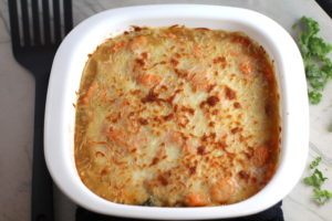 Casserole with melted and browned cheese on top. Smothered Pork Chop Casserole is a true midwestern comfort dish with layers of vegetables and meaty pork chops smothered in a creamy sauce and cheese. The pork chops in this delicious casserole are left whole so that you get an entire portion dripping in goodness in one scoop.
