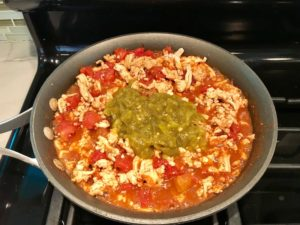 Meat, tomatoes in skillet. This Taco Casserole has corn tortillas layered with browned ground chicken seasoned with smokey mexican spices, black beans, tomatoes, and cheese, and then more cheese.