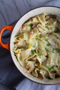 Stovetop Easy Tuna Casserole in a pot on counter. This is a creamy and delicious comfort dish with tuna and noodles and a surprise pop of sweet from Pimiento.  This easy recipe is completely from scratch (no canned soup here!) but I can promise you it's so easy and only takes 30 minutes because it's a Casserole that you can make entirely on the stove top!