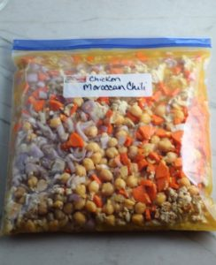 Moroccan Chicken Chili in a freezer bag labeled on counter. This chili with Chickpeas is loaded with comforting and healthy ingredients and spices. You get warmth from Ginger, Turmeric, Garlic, and Coriander. Then tons of hearty flavor from browned ground chicken and Shallots. And creaminess from the Carrots and Chickpeas. You can make it ahead and freeze it until you are ready to cook it!