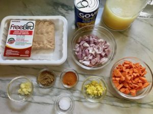 All raw ingredients on counter for Moroccan Chicken Chili with Chickpeas is loaded with comforting and healthy ingredients and spices. You get warmth from Ginger, Turmeric, Garlic, and Coriander. Then tons of hearty flavor from browned ground chicken and Shallots. And creaminess from the Carrots and Chickpeas. You can make it ahead and freeze it until you are ready to cook it!