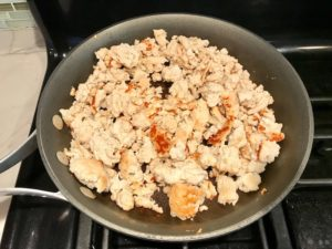 Ground Chicken in a skillet on the stove really browned for Moroccan Chicken Chili with Chickpeas is loaded with comforting and healthy ingredients and spices. You get warmth from Ginger, Turmeric, Garlic, and Coriander. Then tons of hearty flavor from browned ground chicken and Shallots. And creaminess from the Carrots and Chickpeas. You can make it ahead and freeze it until you are ready to cook it!