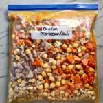 Final labeled freezer bag of all ingredients for Moroccan Chicken Chili with Chickpeas is loaded with comforting and healthy ingredients and spices. You get warmth from Ginger, Turmeric, Garlic, and Coriander. Then tons of hearty flavor from browned ground chicken and Shallots. And creaminess from the Carrots and Chickpeas. You can make it ahead and freeze it until you are ready to cook it!