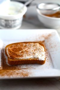 Pumpkin Spice on yogurt on toast with yogurt tub in background. Recipe has 4 simple ingredients and takes minutes to make! PLUS, here are 20 EASY WAYS TO USE this Spice blend, many with no baking at all!