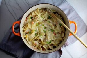 Stove top Easy Tuna Casserole in a pot on counter. This is a creamy and delicious comfort dish with tuna and noodles and a surprise pop of sweet from Pimiento.  This easy recipe is completely from scratch (no canned soup here!) but I can promise you it's so easy and only takes 30 minutes because it's a Casserole that you can make entirely on the stove top!