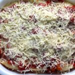 Mozzarella, Parmesan and Tomatoes on Stuffed Pasta Shells layered into a casserole dish for Turkey Ricotta Stuffed Shells in Tomato Sauce. These are the perfect way to repurpose and transform leftover Turkey or Chicken. The Shredded Turkey, Italian seasonings, mozzarella, and ricotta are stuffed in shells and topped with a simple tomato sauce and more melty mozzarella and nutty parmesan, it's a perfect dish that the family will love!