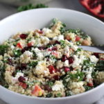 Close up of bowl of Quinoa & Kale Salad with Roasted Chickpeas, Pomegranate, Feta, red pepper, and Creamy Lemon Dressing. #glutenfree #lunch #dinner #healthyrecipes #healthyfood #salads #quinoa #kale