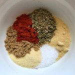 Spices in bowl for Roasted Tofu Croutons. These are seasoned and toasted for the perfect addition to any salad, pasta, rice, or soup! They get a roasted, almost nutty flavor with a salty and smoky seasoned crust with a chewy bite. Super easy to make, low carb and great source of protein! #croutons #salad #tofu #tofurecipes #vegetarian #plantbased #paleo