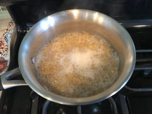 Boiling water with Quinoa for Cilantro Lime Quinoa. It's fluffy, nutty, citrusy, salty, and the perfect accompaniment for any protein or vegetable!  With just a few simple ingredients, you can make this fantastic healthier alternative to rice. #quinoa #quinoarecipes #sides #healthyfood