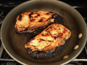 Chicken cooking with char in skillet for Sesame Sweet Chili Chicken recipe. It is slightly sweet, tangy, savory, nutty, with a touch of heat. You can prepare it days ahead, it takes just minutes to prepare, minutes to cook, and everyone will love it!! #chicken #marinades #easydinner #easychicken #chickenrecipes #easysauces #healthydinner #healthyfood #healthyrecipes
