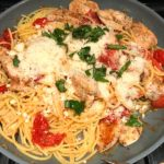 Skillet with Chicken and Cherry Tomato Pasta with basil and parmesan. It's easy and so delicious! #pasta #tomatoes #easydinner #dinner #easyrecipes #healthydinner #chicken