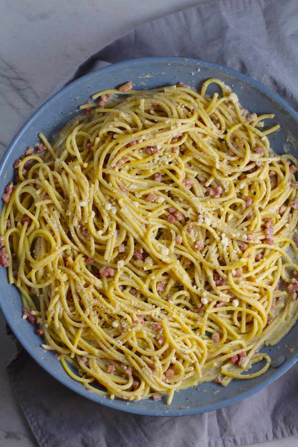 Pancetta, Parmesan, and Pepper Pasta in skillet. The Pancetta gives a salty and slightly peppery flavor, Parmesan cheese creates a nutty and creamy sauce, and the ground black pepper gives a peppery flavor that makes this pasta stand out. #pasta #easypasta #easydinner #dinner #italian #familydinner #onpotdinners #onepandinners #parmesan
