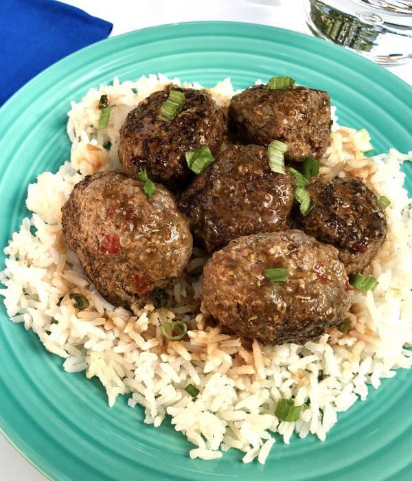 Meatballs on table with dipping sauce vert cropping